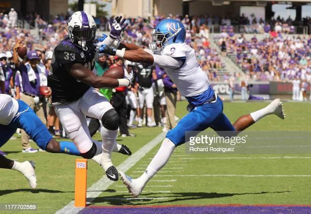 Running back Sewo Olonilua of the TCU Horned Frogs scores a touchdown in the second quarter against linebacker Najee Stevens-McKenzie of the Kansas...
