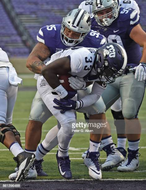 Running back Sewo Olonilua of the TCU Horned Frogs scores a touchdown against the Kansas State Wildcats during the second half on October 14 2017 at...