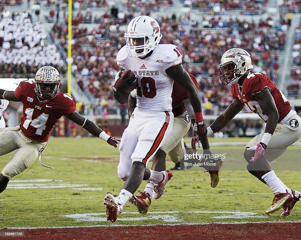 Running back Shadrach Thornton #10 of the North Carolina State Wolfpack scores a touchdown during the game against Florida State Seminoles at Bobby Bowden Field at Doak Campbell Stadium on October 26, 2013 in Tallahassee, Florida. The 3rd ranked Florida State Seminoles defeated North Carolina State Wolfpack 49-17.