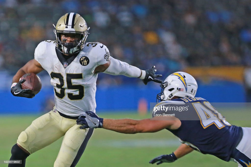 Running back Shane Vereen #35 of the New Orleans Saints avoids the tackle by linebacker Nick Dzubnar #48 of the Los Angeles Chargers during a preseason NFL game at StubHub Center on August 25, 2018 in Carson, California.