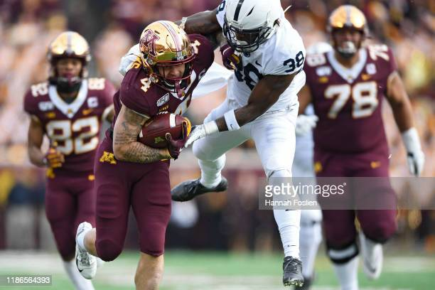 Running back Shannon Brooks of the Minnesota Golden Gophers rushes past safety Lamont Wade of the Penn State Nittany Lions during the second quarter...