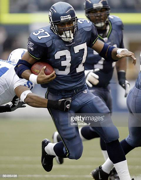 Running back Shaun Alexander of the Seattle Seahawks breaks a tackle by linebacker Gilbert Gardner of the Indianapolis Colts in the first half at...