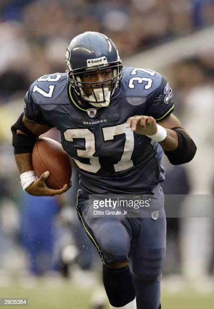 Running back Shaun Alexander of the Seattle Seahawks carries the ball during the game against the Arizona Cardinals on December 21 2003 at Seahawks...