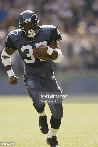 Running back Shaun Alexander of the Seattle Seahawks carries the ball during the game with the St Louis Rams at Qwest Field on October 10 2004 in...