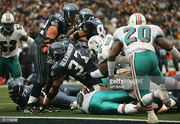 Running back Shaun Alexander of the Seattle Seahawks carries the ball across the goal line for a touchdown during the second quarter against the...