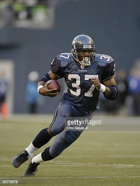 Running back Shaun Alexander of the Seattle Seahawks carries the ball against the Atlanta Falcons during the game at Qwest Field on January 2 2005 in...