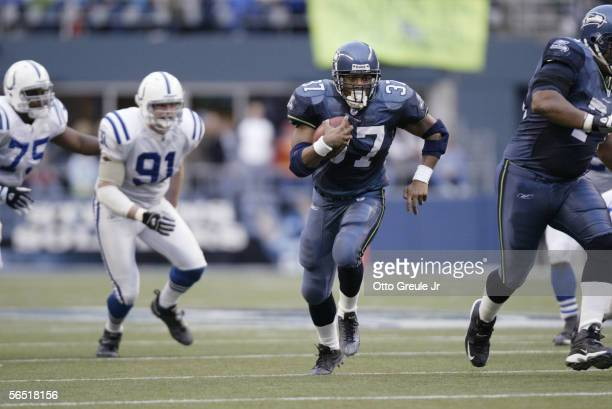 Running back Shaun Alexander of the Seattle Seahawks carries the ball against the Indianapolis Colts at Qwest Field on December 24 2005 in Seattle...
