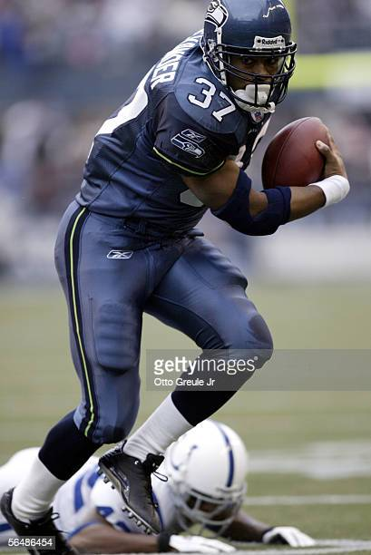 Running back Shaun Alexander of the Seattle Seahawks rushes against the Indianapolis Colts in the first half at Qwest Field on December 24 2005 in...