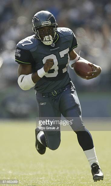 Running back Shaun Alexander of the Seattle Seahawks rushes in the 1st quarter against the St Louis Rams at Qwest Field on October 10 2004 in Seattle...