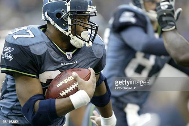 Running back Shaun Alexander of the Seattle Seahawks rushes in the third quarter of the Seahawks' game against the San Francisco 49ers on December 11...