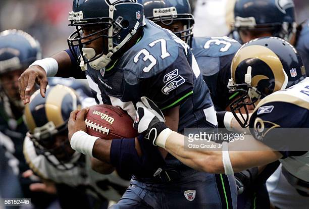 Running back Shaun Alexander of the Seattle Seahawks tries to break a tackle by safety Adam Archuleta of the St Louis Rams during the first quarter...