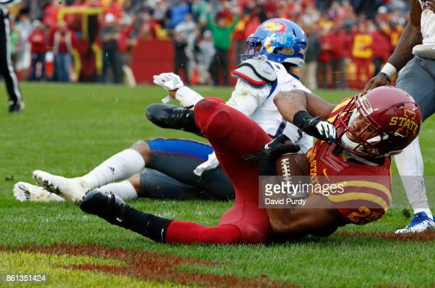 Running back Sheldon Croney Jr #25 of the Iowa State Cyclones falls into the end zone for a touchdown as cornerback Hasan Defense of the Kansas...