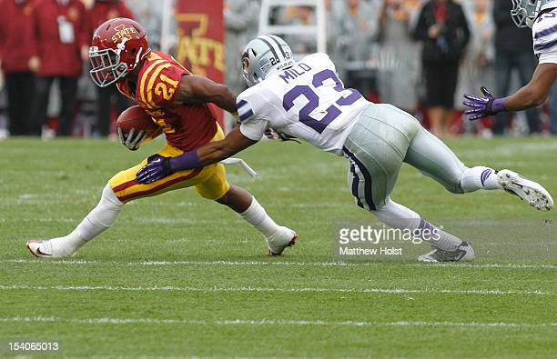Running back Shontrelle Johnson of the Iowa State Cyclones rushes up field during the first quarter past defensive back Jarard Milo of the Kansas...