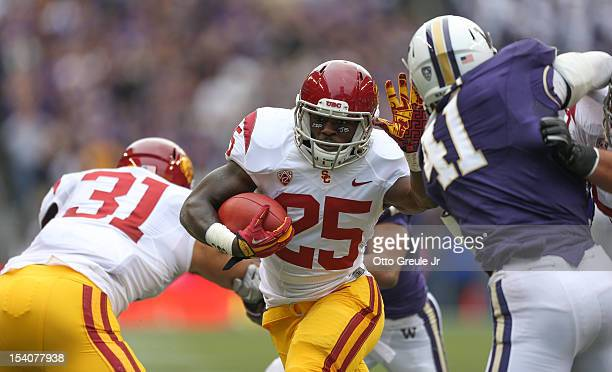 Running back Silas Redd of the USC Trojans rushes for a touchdown against the Washington Huskies on October 13, 2012 at CenturyLink Field in Seattle,...