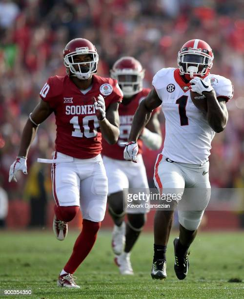 Running back Sony Michel of the Georgia Bulldogs scores a 75yard touchdown run in the first half against the Oklahoma Sooners in the 2018 College...