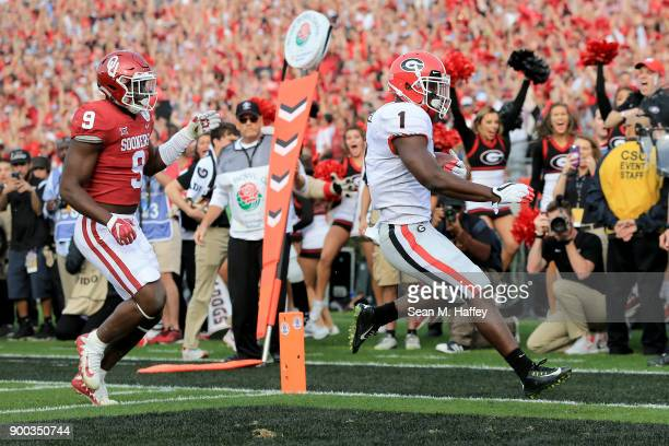 Running back Sony Michel of the Georgia Bulldogs scores a touchdown on a 13yard reception in the first quarter against the Oklahoma Sooners in the...