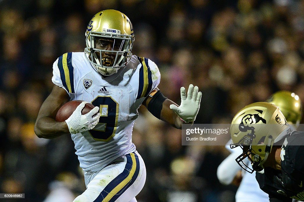 Running back Soso Jamabo #9 of the UCLA Bruins rushes against the Colorado Buffaloes at Folsom Field on November 3, 2016 in Boulder, Colorado.