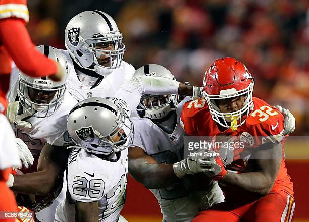 Running back Spencer Ware of the Kansas City Chiefs carries the ball during the game against the Oakland Raiders at Arrowhead Stadium on December 8...