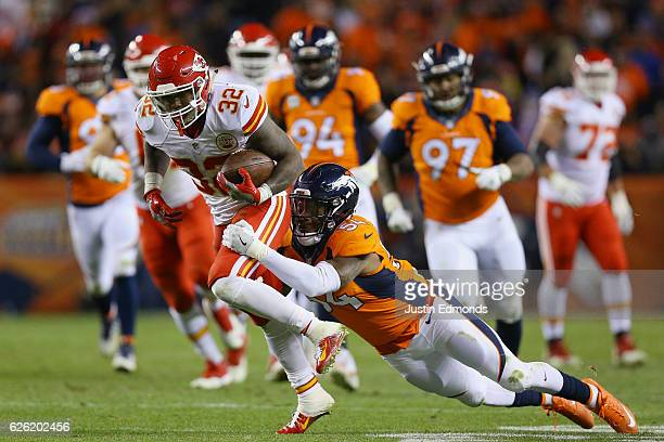 Running back Spencer Ware of the Kansas City Chiefs catches a pass and is tackled by inside linebacker Brandon Marshall of the Denver Broncos in the...