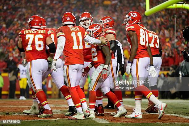 Running back Spencer Ware of the Kansas City Chiefs is congratulated by quarterback Alex Smith after scoring a touchdown against the Pittsburgh...