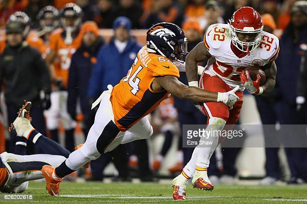 Running back Spencer Ware of the Kansas City Chiefs is tackled by inside linebacker Brandon Marshall of the Denver Broncos in the third quarter of...