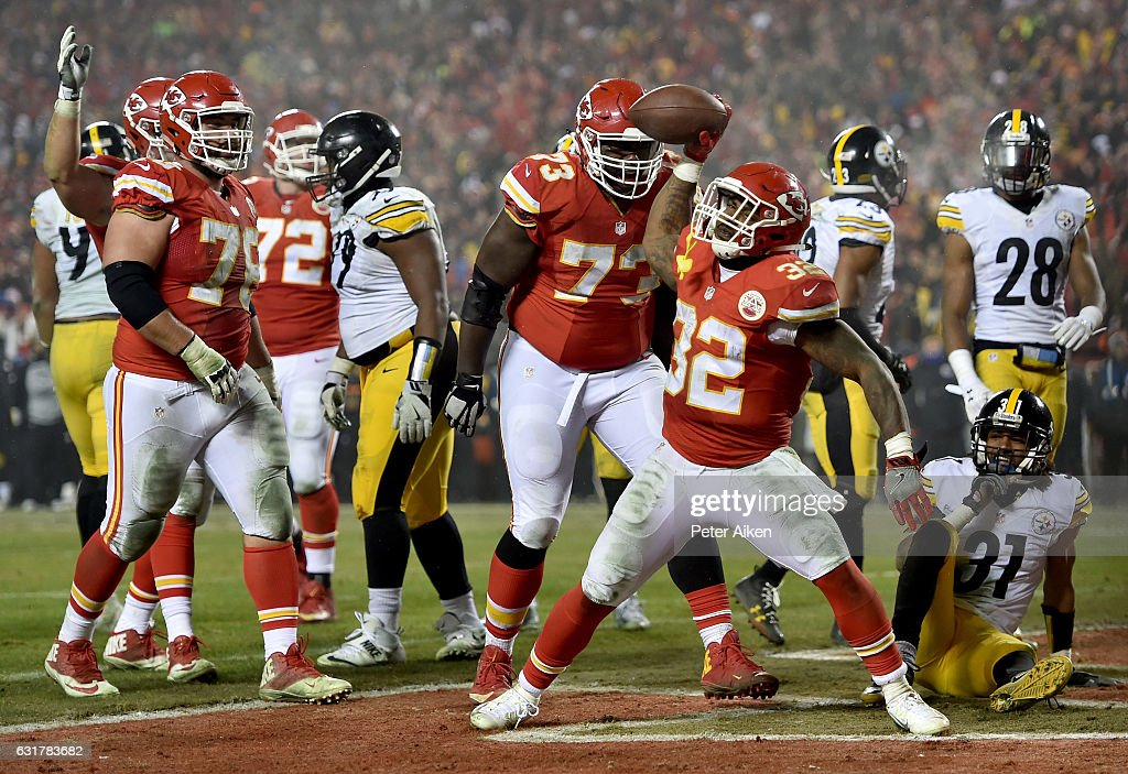 Running back Spencer Ware #32 of the Kansas City Chiefs spikes the ball after a touchdown run against Pittsburgh Steelers during the second half in the AFC Divisional Playoff game at Arrowhead Stadium on January 15, 2017 in Kansas City, Missouri.