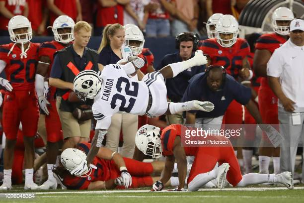 Running back Squally Canada of the Brigham Young Cougars dives with the football during the first half of the college football game against the...