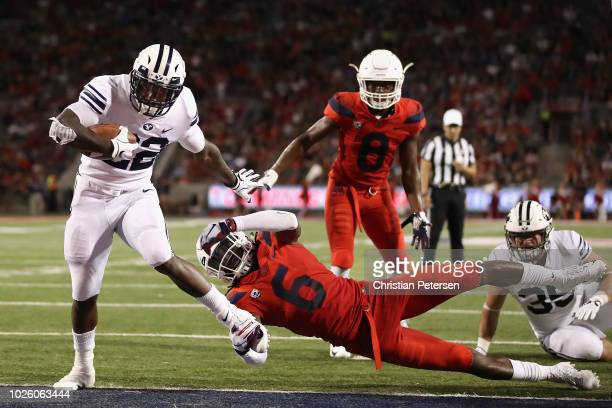 Running back Squally Canada of the Brigham Young Cougars scores a one yard rushing touchdown past safety Demetrius FlanniganFowles of the Arizona...