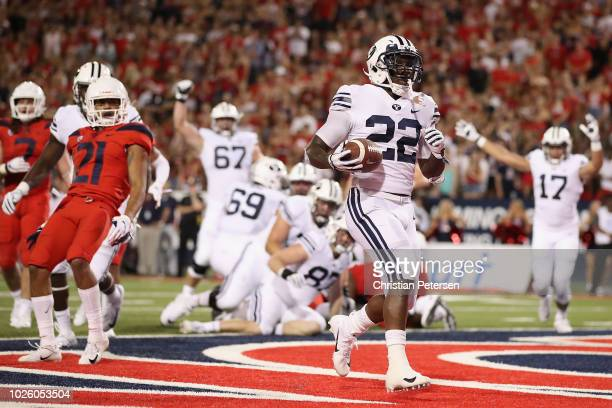 Running back Squally Canada of the Brigham Young Cougars scores on a one yard rushing touchdown against the Arizona Wildcats during the first half of...
