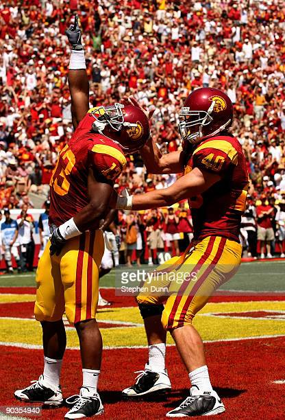 Running back Stafon Johnson of the USC Trojans celebrates with tight end Rhett Ellison after scoring the Trojans' first touchdown against the San...