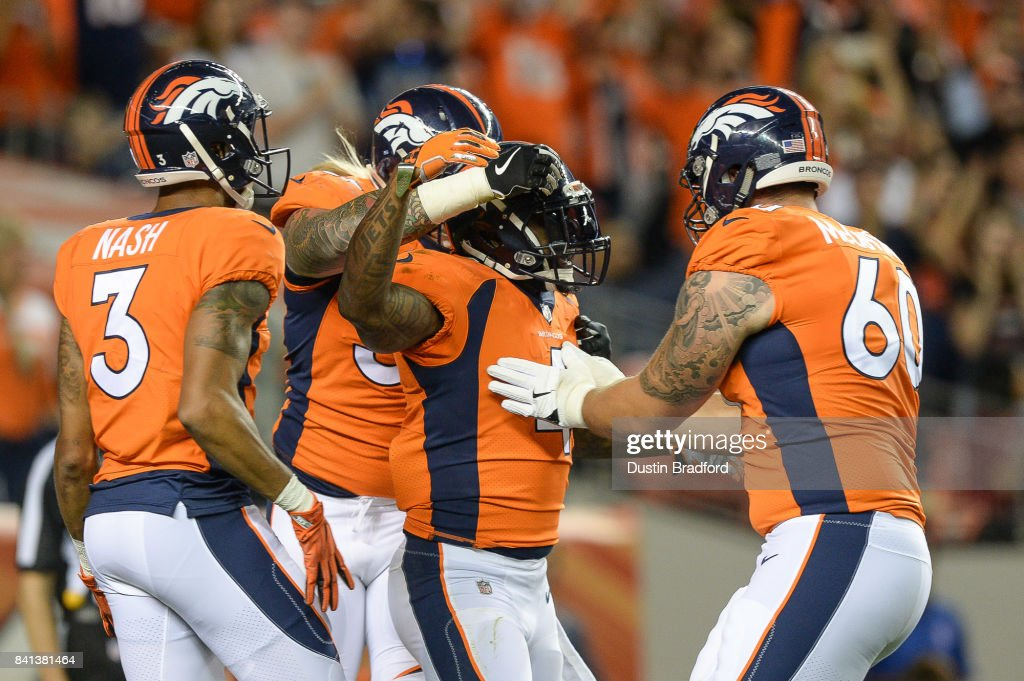 Running back Stevan Ridley #4 of the Denver Broncos celebrates after scoring a second quarter touchdown against the Arizona Cardinals during a preseason NFL game at Sports Authority Field at Mile High on August 31, 2017 in Denver, Colorado.