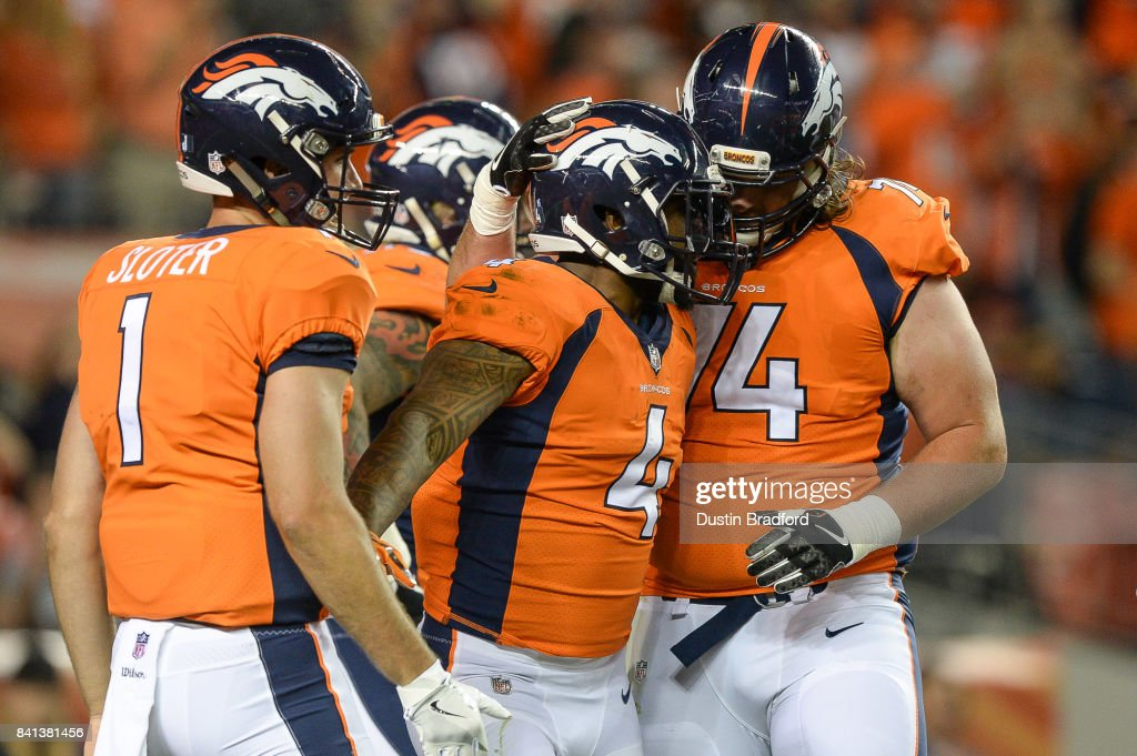 Running back Stevan Ridley #4 of the Denver Broncos celebrates with Kyle Sloter #1 and Ty Sambrailo #74 after scoring a second quarter touchdown against the Arizona Cardinals during a preseason NFL game at Sports Authority Field at Mile High on August 31, 2017 in Denver, Colorado.