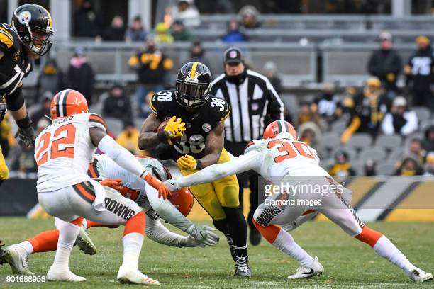 Running back Stevan Ridley of the Pittsburgh Steelers is tackled by linebacker James Burgess Jr #52 cornerback Jason McCourty and safety Jabrill...