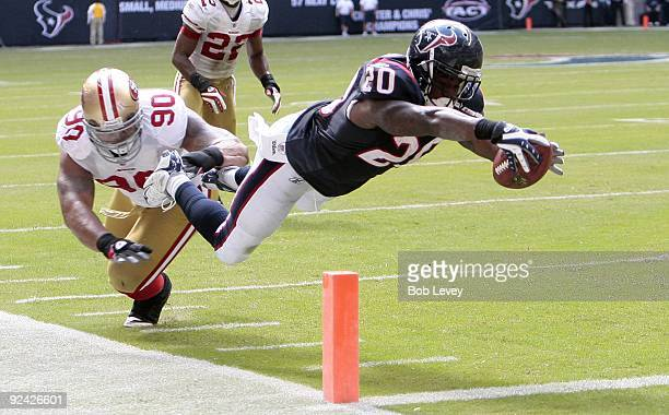 Running back Steve Slaton of the Houston Texans avoids a tackle by defensive tackle Isaac Sopoaga of the San Francisco 49ers as he dives for the...