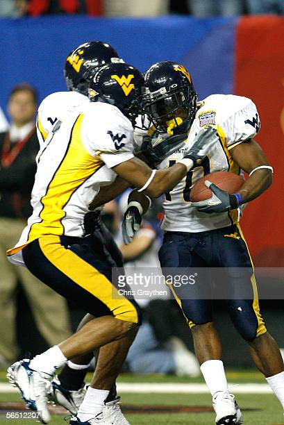 Running back Steve Slaton of the West Virginia Mountaineers and teammates celebrate after Slaton's a 52 yard touchdown against the Georgia Bulldogs...