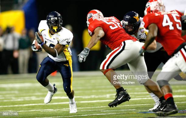 Running back Steve Slaton of the West Virginia Mountaineers runs with the ball against the Georgia Bulldogs defense during the 1st quarter of the...