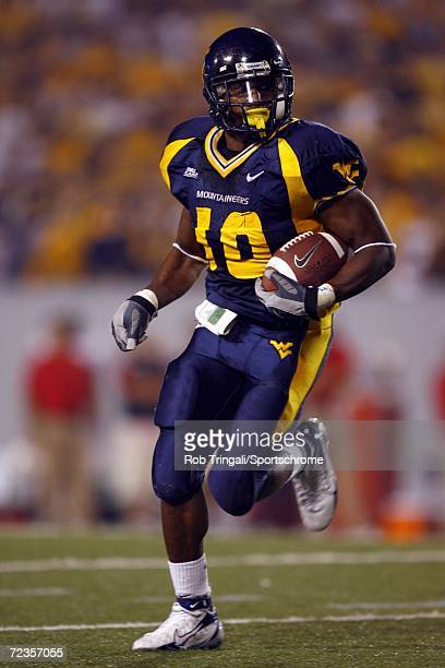 Running Back Steve Slaton of West Virginia Mountaineers rushes against the Maryland Terrapins at Milan Puskar Stadium the home of Mountaineer Field...