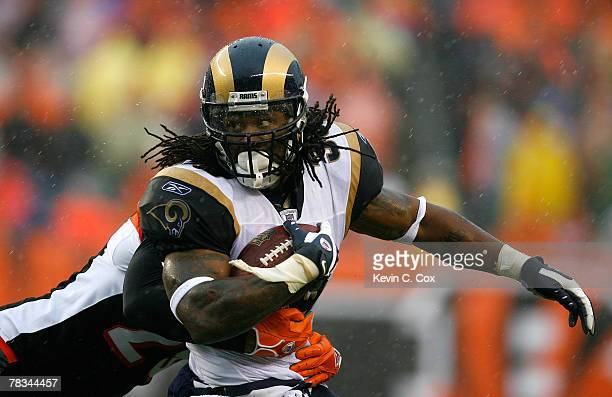 Running back Steven Jackson of the St Louis Rams is tackled by cornerback Leon Hall of the Cincinnati Bengals during the first half at Paul Brown...