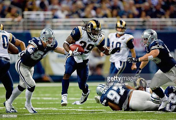 Running back Steven Jackson of the St Louis Rams runs with the ball against the Dallas Cowboys during their NFL game at Edward Jones Dome on October...