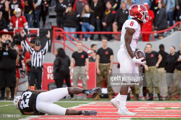 Running back Stevie Scott III of the Indiana Hoosiers scores a touchdown against Dicaprio Bootle at Memorial Stadium on October 26 2019 in Lincoln...