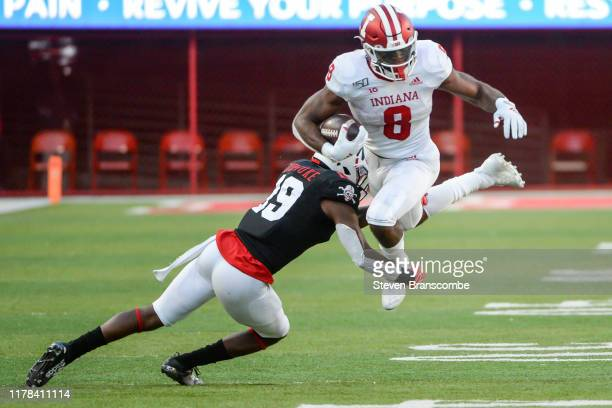 Running back Stevie Scott III of the Indiana Hoosiers tries to avoid a tackle from safety Marquel Dismuke of the Nebraska Cornhuskers at Memorial...