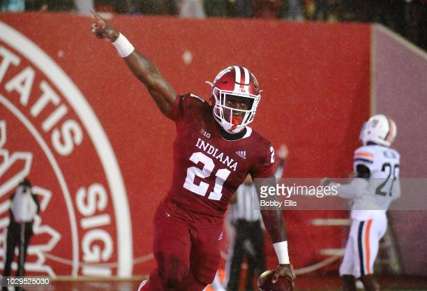 Running back Stevie Scott of the Indiana Hoosiers celebrates after scoring a touchdown during the first quarter of the game against the Virginia...
