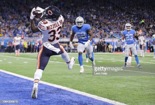 Running back Taquan Mizzell of the Chicago Bears catches a pass for a touchdown against the Detroit Lions during the second quarter at Ford Field on...