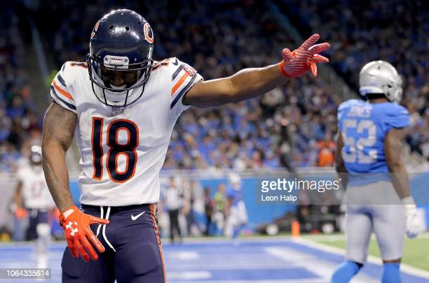 Running back Taquan Mizzell of the Chicago Bears celebrates after catching a pass for a touchdown against the Detroit Lions during the second quarter...