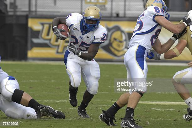 Running back Tarrion Adams of the Tulsa Golden Hurricane rushes upfield against the University of Central Florida Knights at Bright House Stadium on...