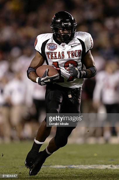 Running back Taurean Henderson of the Texas Tech Red Raiders runs against the California Golden Bears during the Pacific Life Holiday Bowl at...