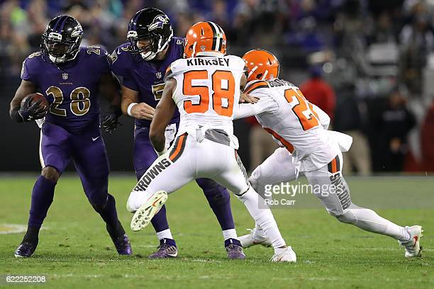 Running back Terrance West of the Baltimore Ravens carries the ball against inside linebacker Christian Kirksey of the Cleveland Browns in the third...