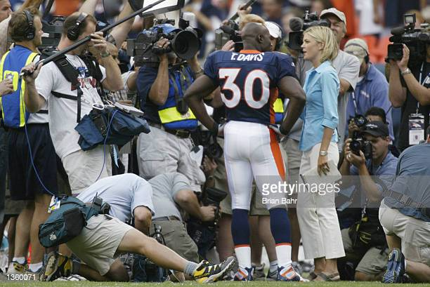 Running back Terrell Davis of the Denver Broncos gives an interview at midfield to ABC Broadcaster Melissa Stark regarding his possible retirement...