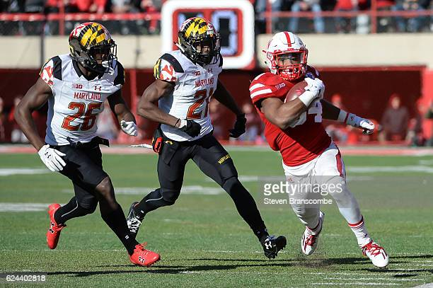Running back Terrell Newby of the Nebraska Cornhuskers runs from defensive back Darnell Savage Jr #26 and defensive back RaVon Davis of the Maryland...