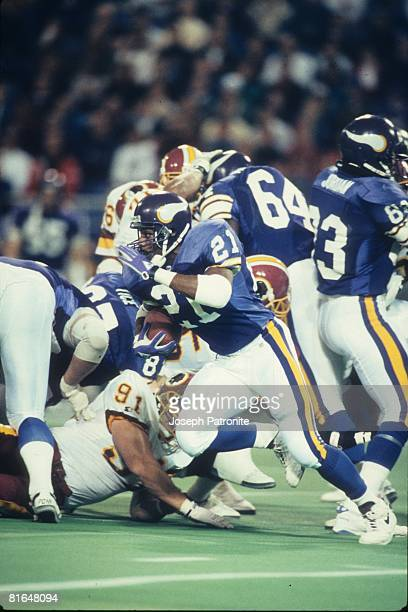Running back Terry Allen of the Minnesota Vikings runs upfield against the Washington Redskins in the 1992 NFC Wildcard Game at the Metrodome on...